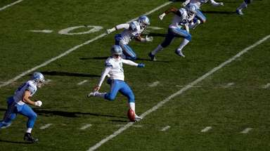 Detroit's Sam Martin kicks off during the first