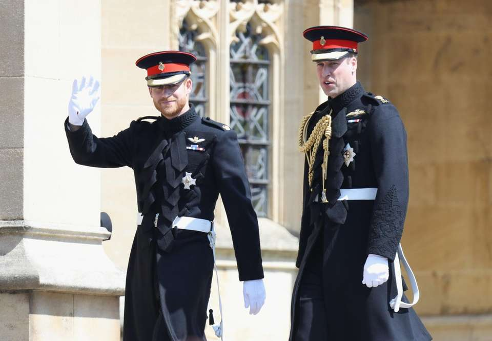 Prince Harry arrives with his brother, Prince William,