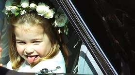 Princess Charlotte sticks out her tongue as she