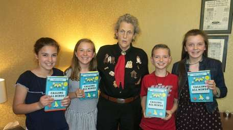 Author Temple Grandin, center, with Kidsday reporters, from