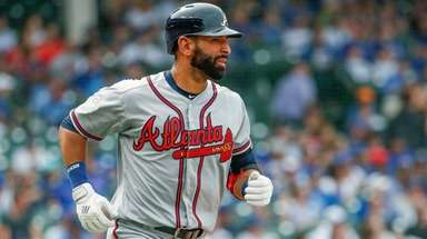 The Braves' Jose Bautista watches his three-run home