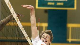 Chaminade's Brian Noble tips the ball over for