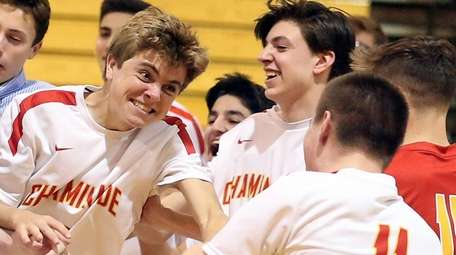Chaminade celebrates win during the CHSAA boys volleyball