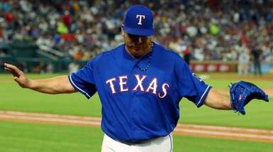 Rangers starting pitcher Bartolo Colon gestures as he