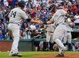 The Yankees' Neil Walker, left, greets Gleyber Torres