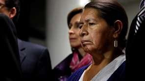 Rosario Lucero, mother of Marcelo Lucero, listens during