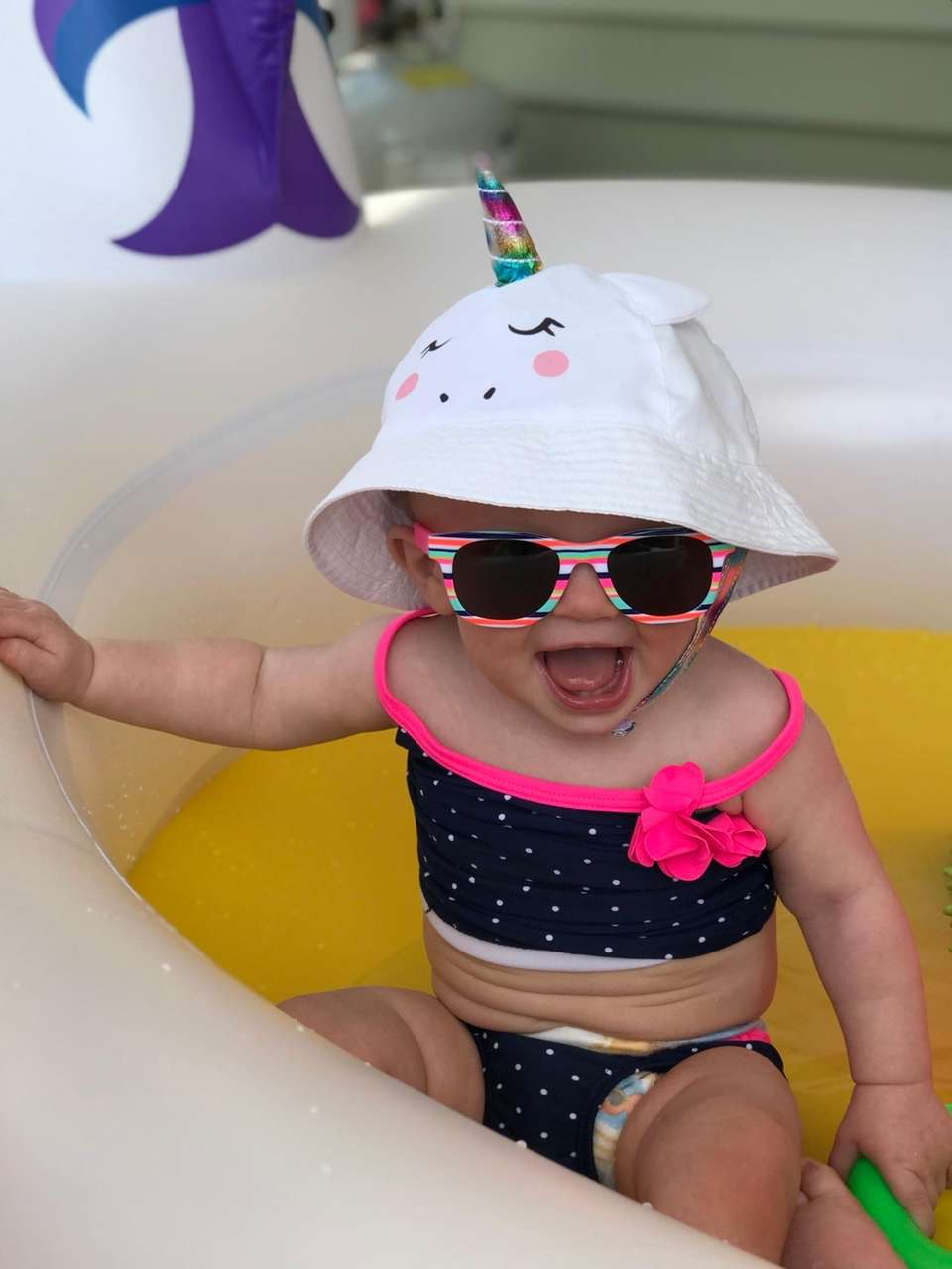 Haylee enjoying her first time in the pool