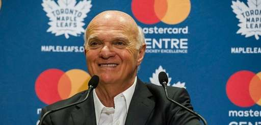 Lou Lamoriello speaks to reporters during a press