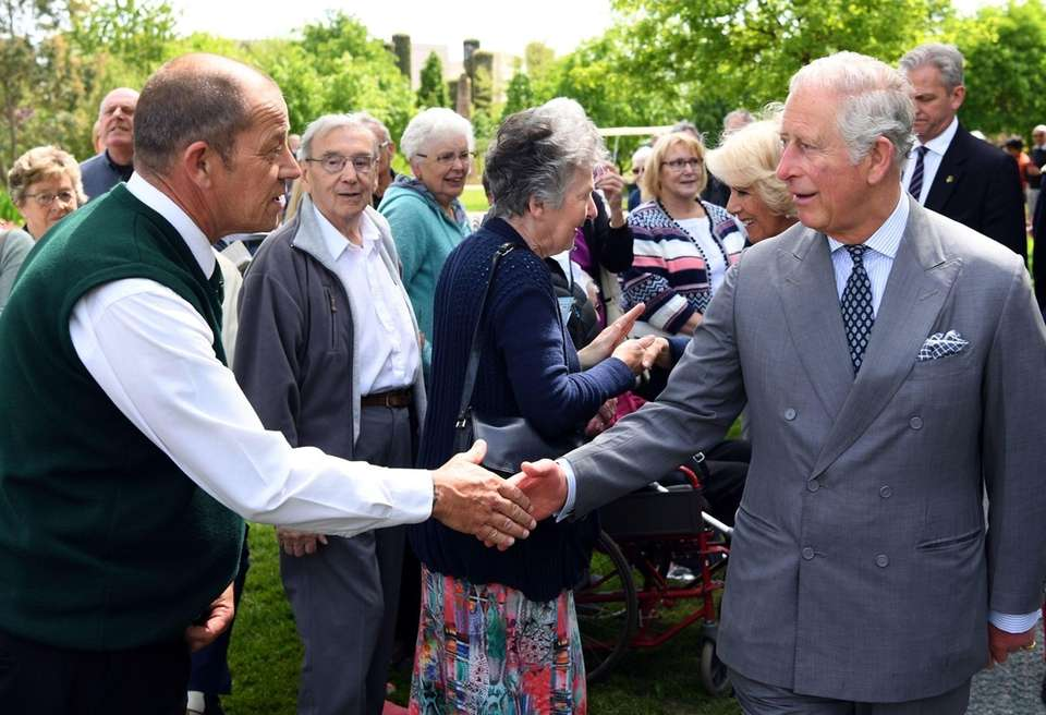Prince Charles greets well-wishers at the dedication service