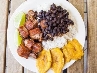 Chicharrón de cerdo (fried pork crackling) with arroz