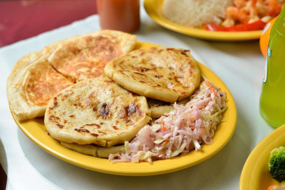 Pupusas filled with shredded beef, pork and cheese