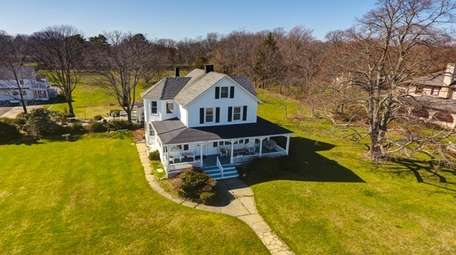 The three-bedroom, two-bathroom Center Moriches home has glass-paneled