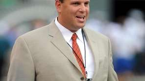 New York Jets general manager Mike Tannenbaum watches