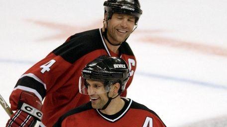 New Jersey Devils' Scott Niedermayer, center, celebrates his