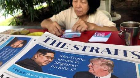 A stack of newspapers with a photo of