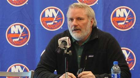 Garth Snow, Islanders general manager, answers questions from