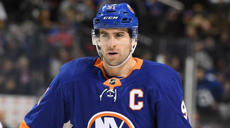Islanders center John Tavares looks on before a
