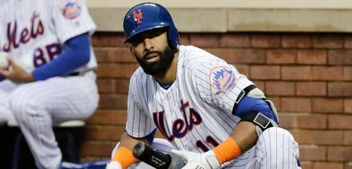 The Mets' Jose Bautista stretches while on deck
