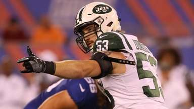 Jets linebacker Dylan Donahue lines up against the