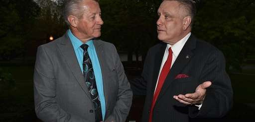 Tom Daly, left, the former dean of Dowling's