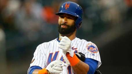 Jose Bautista of the Mets reacts after his