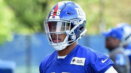 Giants running back Saquon Barkley looks on from