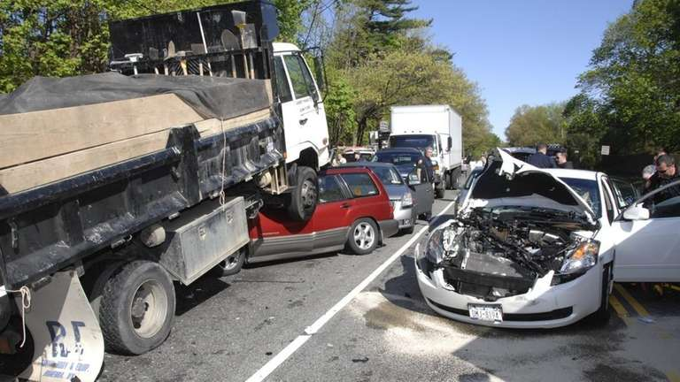 Truck hits oncoming car, causes chain-reaction crash   Newsday