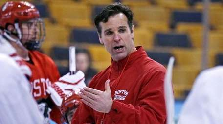 Boston University head coach David Quinn talks to