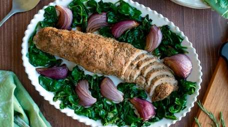 Seasoned pork roasted with red onion wedges and