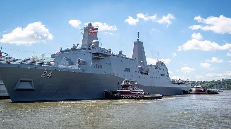 The USS Arlington docks at Pier 90 after