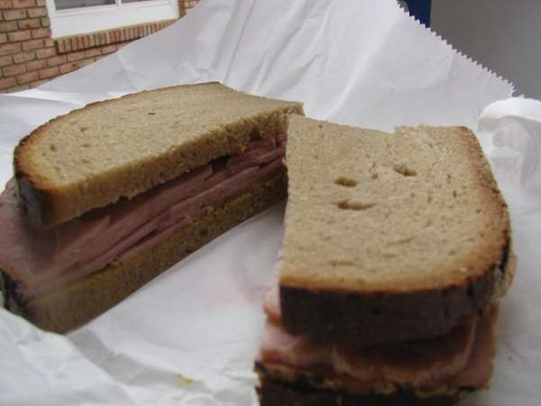 Sandwich of kielbasa loaf on rye at Taste