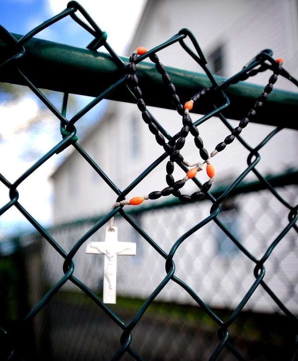 Rosary beads are wrapped into a chain link