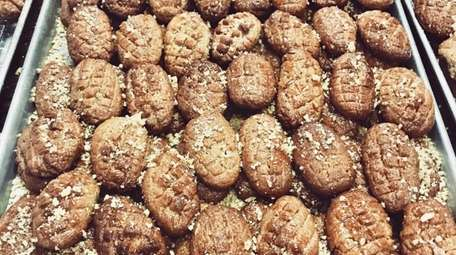 Melomakarona is a walnut-flavored cookie soaked in honey.