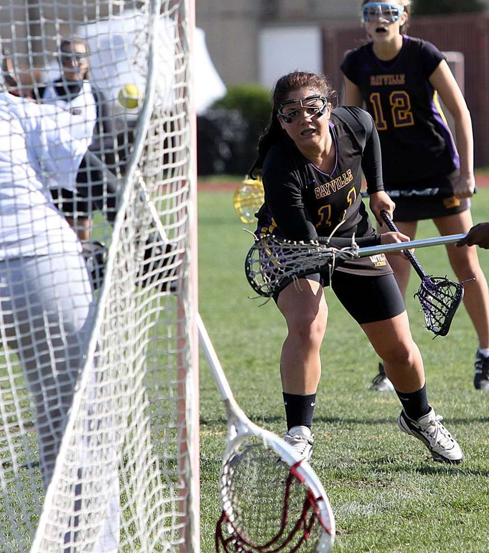 Sayville's Emma Ferriera scores to give her team