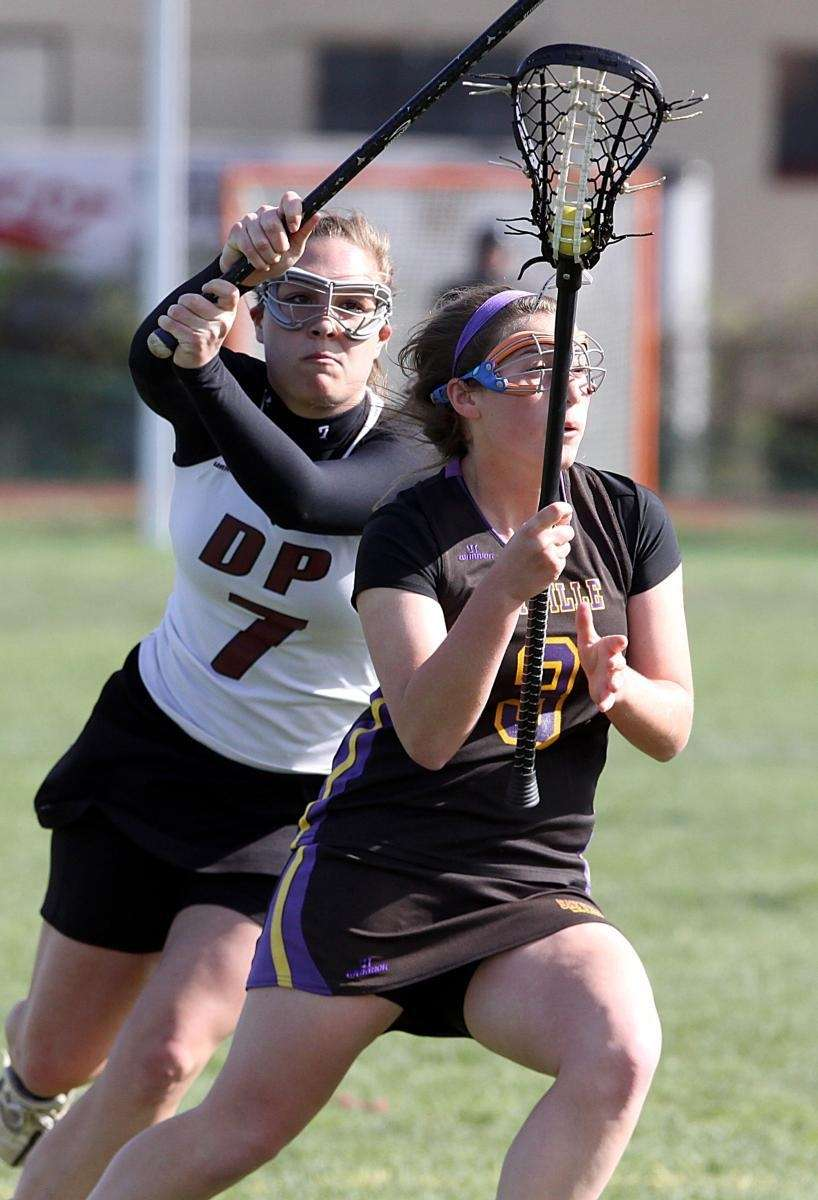 Sayville's Emily Meier looks for her shot as