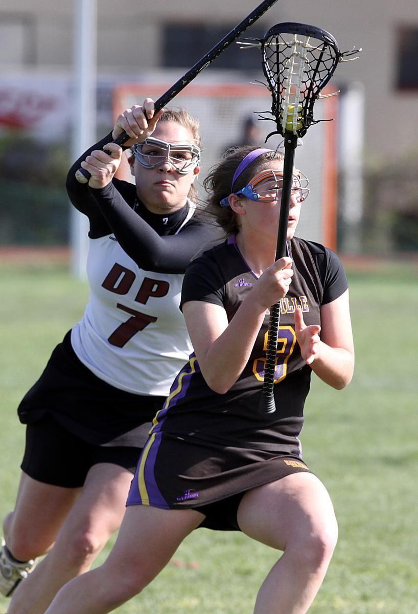 Sayville's Emily Meier looks for her shot as