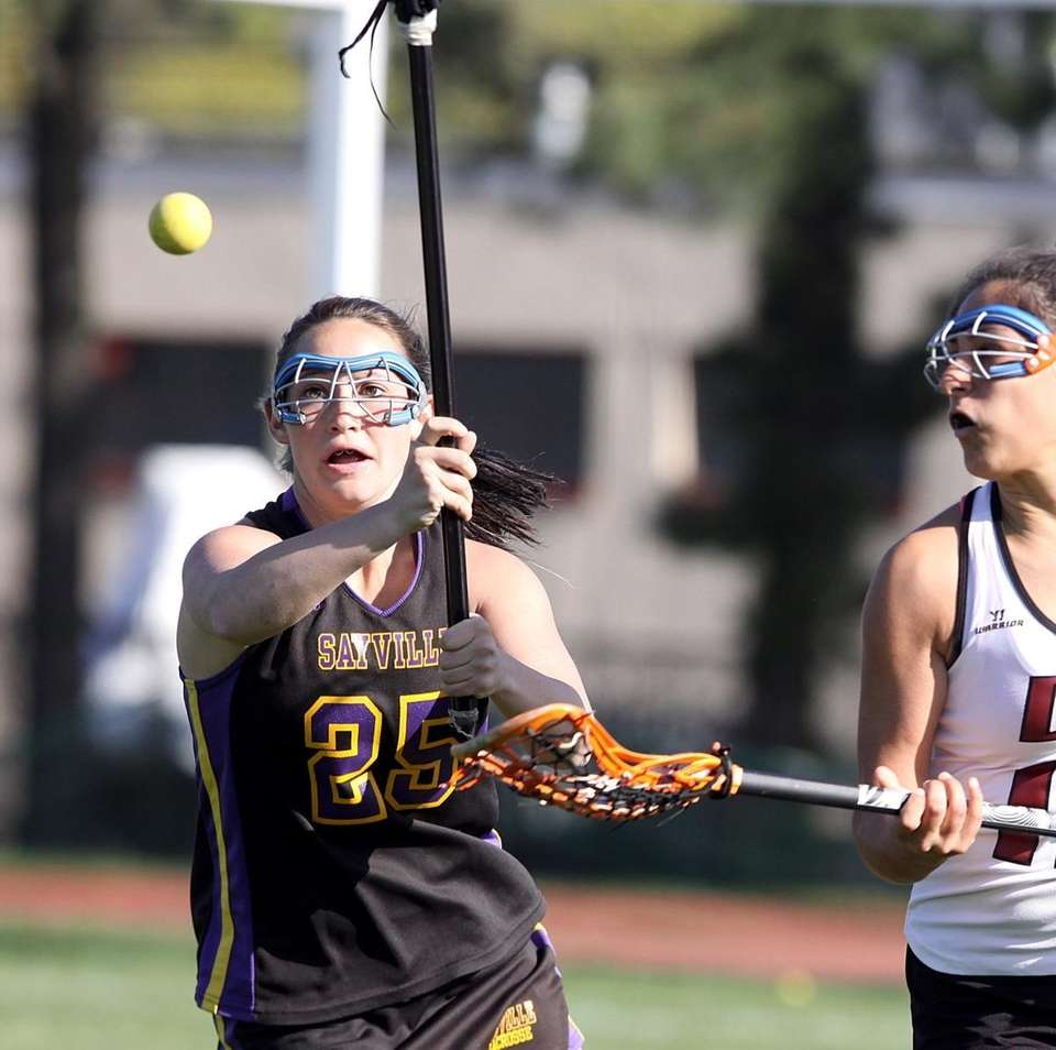 Sayville's Olivia Cabral fights for ball against Deer