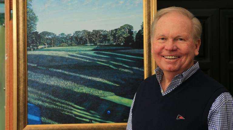Golf artist George Lawrence poses with a print