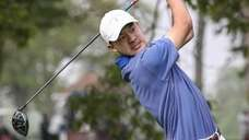 Adam Xiao of Manhasset tees off on the