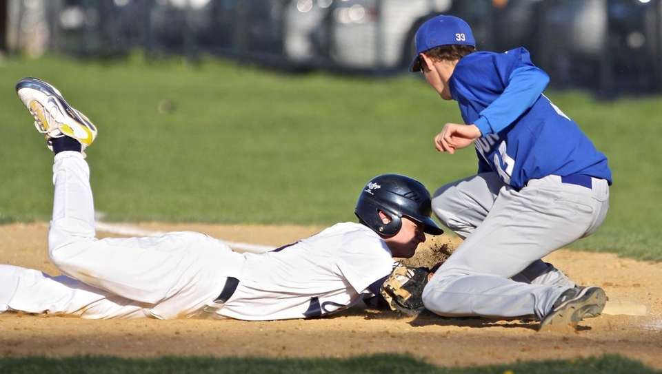 Massapequa's Mike Marocchi gets back to first base