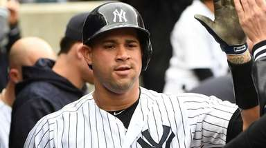 Yankees catcher Gary Sanchez is greeted in the