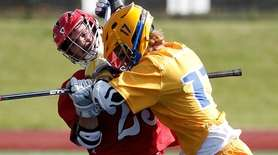 East Islip's Brendan Cutrone (23) takes a high