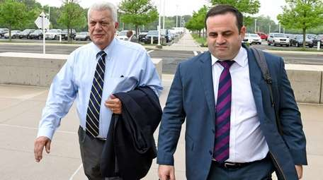 John Venditto, left, arrives at federal court in