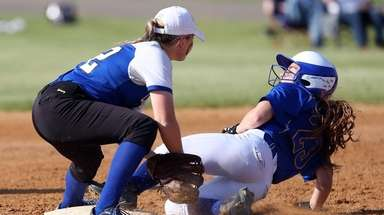 East Meadow's Stephanie Christoforatos steals second during Game