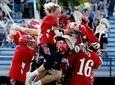 The East Islip boys lacrosse team jumps on
