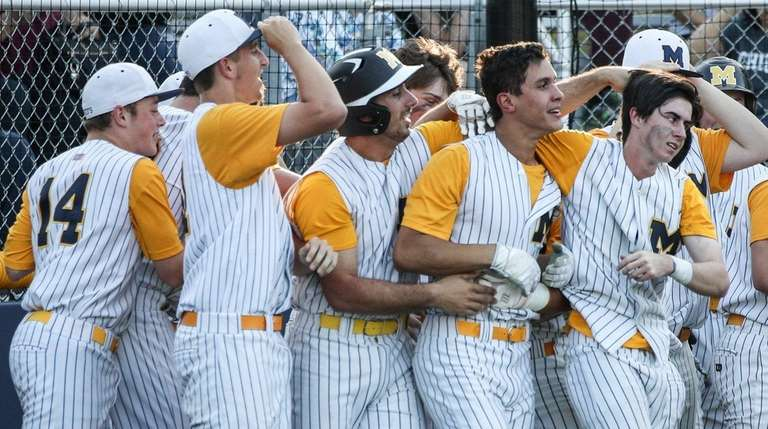 Massapequa celebrates their two-game sweep of Plainview-Old Bethpage