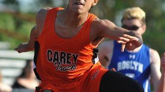 Kenneth Ciulla of Carey wins the boys 110-meter