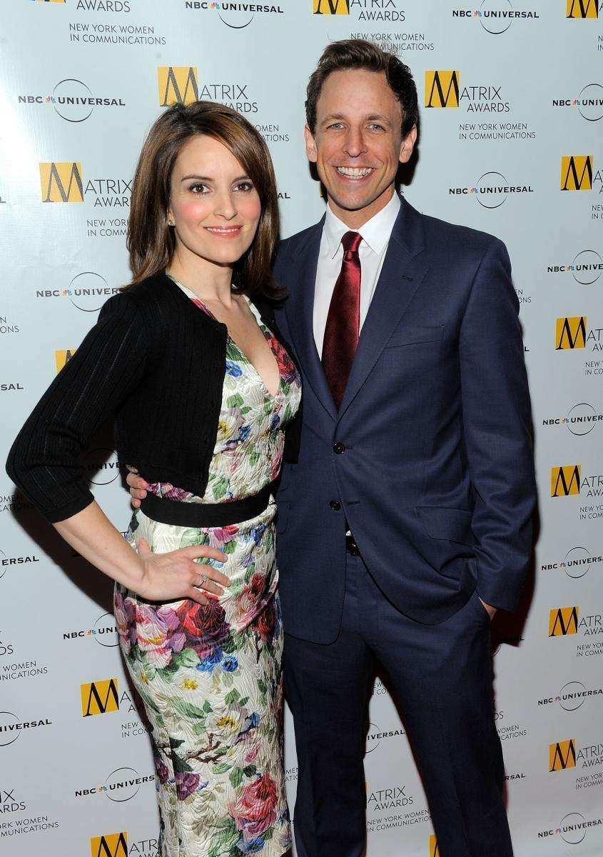Comedians Tina Fey and Seth Meyers pose for