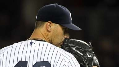 Yankees' starting pitcher Andy Pettitte pitches in the