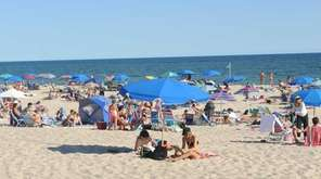 Beachgoers enjoy a late summer day at Coopers